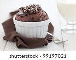 fresh chocolate muffin in a ramekin with fork - stock photo