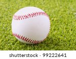 A baseball over a green grass field - stock photo