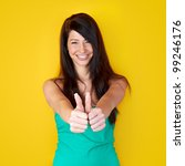 young smiling happy woman with thumbs up - stock photo