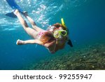 young woman diving on a breath... | Shutterstock . vector #99255947