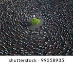 lonely tree surrounded by cars - stock photo