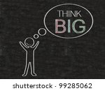 man with think bubble think big written on blackboard background, high resolution - stock photo