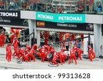 SEPANG, MALAYSIA - MARCH 25: Ferrari F1 Team crews does pit-stop practice at the 2012 F1 Petronas Malaysian Grand Prix at Sepang International Circuit on March 25, 2012 in Sepang, Malaysia - stock photo