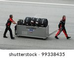 SEPANG, MALAYSIA-MARCH 25 : Pit crews move gear at Petronas F1 Malaysian Grand Prix at Sepang Circuit on March 25, 2012 in Sepang, Malaysia - stock photo