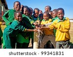 MALOLOTJA, SWAZILAND-JULY 31: Unidentified Swazi schoolboys on July 31, 2008 in Malolotja Government School, Malolotja, Swaziland. Close to 10% of Swazilandâ's population are orphans, due to HIV/AIDS. - stock photo