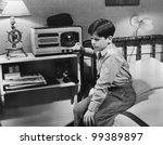 boy listening to radio in... | Shutterstock . vector #99389897