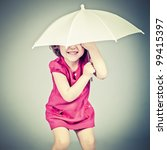 funny little girl with umbrella - stock photo