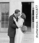 couple kissing outside | Shutterstock . vector #99421877