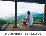 back view of male tourist... | Shutterstock . vector #994321903