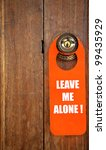 Leave me alone sign in door - stock photo
