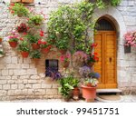 Colorful flowers outside a home in the Italian hill town of Assisi - stock photo