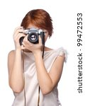 Attractive young girl with a camera over white background - stock photo