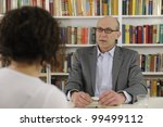woman talking to a consultant, lawyer or advisor - stock photo