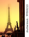 eiffel tower and silhouettes of ...