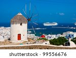 view of Mykonos, windmill and old port with cruise ship - stock photo