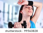 Woman working out at the gym - stock photo