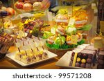 Assorted chocolates sweets in a shop - stock photo