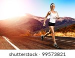 Runner - woman running outdoors on road - stock photo