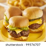 three mini burger sliders with cheese and pickeles. - stock photo
