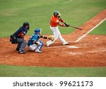 PINGTUNG, TAIWAN, APRIL 8: Batter Zhang of the President Lions hits the ball in a game of the China Pro Baseball League against the Lamigo Monkeys. The Lions won 2:0 on April 8, 2012 in Pingtung. - stock photo