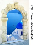Traditional greek church  through an old window in Santorini island, Greece - stock photo