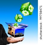 Businessman hand holding with industrial box image and green industrial cube concept. - stock photo