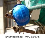 blue worker helmet on the scaffolding during the lunch breke - stock photo