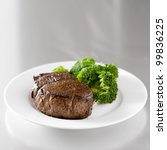 beef steak fillet with broccoli and copy space composition on metal surface - stock photo