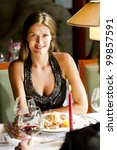 Elegant woman at the restaurant - stock photo