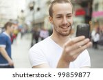 young man with mobile phone... | Shutterstock . vector #99859877