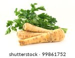 Parsnip and parsley on a white background - stock photo