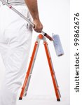 Low angle view of a painter with ladder - stock photo