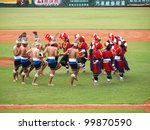 PINGTUNG, TAIWAN, APRIL 8: Aboriginal dancers perform before a Pro Baseball League game between the President Lions and the Lamigo Monkeys. The Lions won 2:0 on April 8, 2012 in Pingtung. - stock photo
