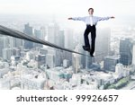 business man balancing on the... | Shutterstock . vector #99926657