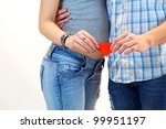 Loving Couple, Holding Red Heart In Hand. - stock photo