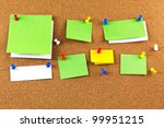Cork board with blank notes. - stock photo