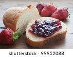 strawberries and strawberry jam on sliced bread - stock photo