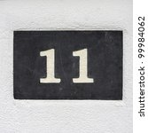House number 11 engraved in natural stone - stock photo
