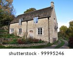 Old Stone House on a Country Road in Rural England - stock photo