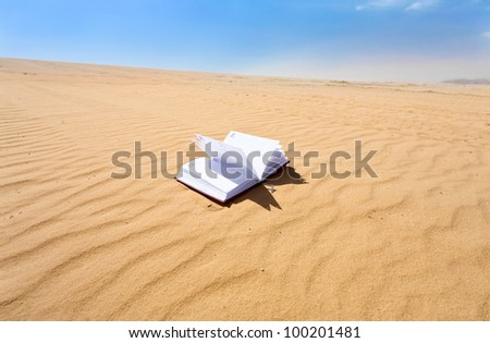 note book in sand dune of wadi