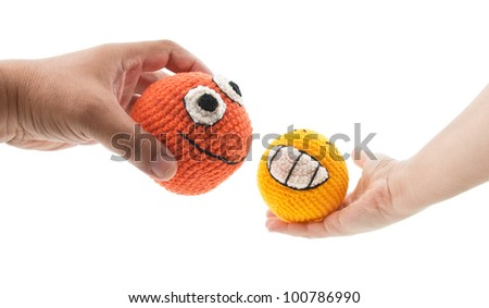 two crochet smileys in woman