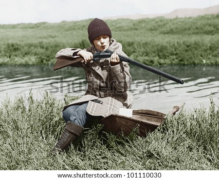 female hunter with gun near