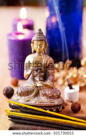 statue of buddha  incense and