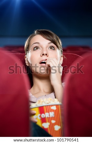 young woman with popcorn at the