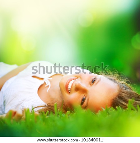 spring girl lying on the field