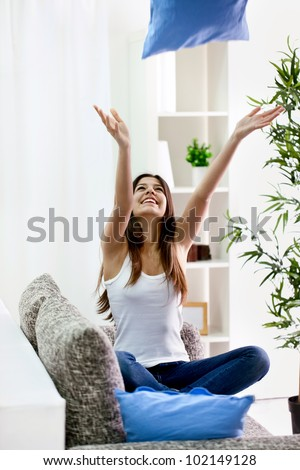 teenager girl throwing  pillow