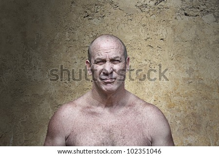 muscular scowling man in