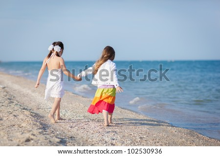 two little girls walking at the