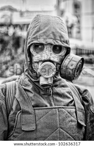 portrait of man in gas mask on