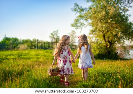 two cute little girls walking